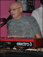 Jimmie of Sojourn Rocs plays keyboards and sings vocals