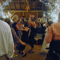 Dancers at wedding reception, band is Sojourn Rocs